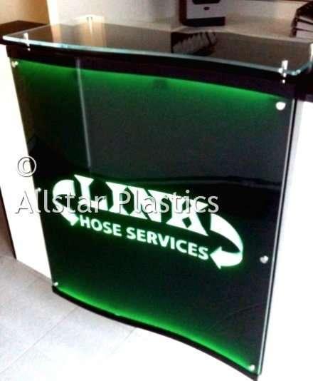 3D engraved panel LED lit moulded to fit reception desk.